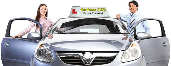 Image of a driving instructor, with a pupil, both stood by the Go-Pass (UK) tuition vehicle.